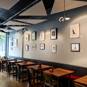 Display of prints and originals at Pomegranate Café Restaurant
