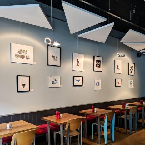 Display of prints and originals at Pomegranate Café Restaurant