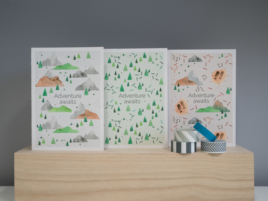 Product photograph of my trio of nature-inspired greetings cards, with 'Adventure awaits' on the front of each card.