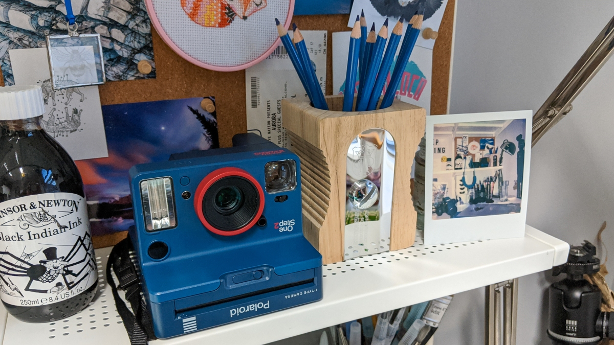 Photograph showing my Polaroid x Stranger Things camera on my studio shelves