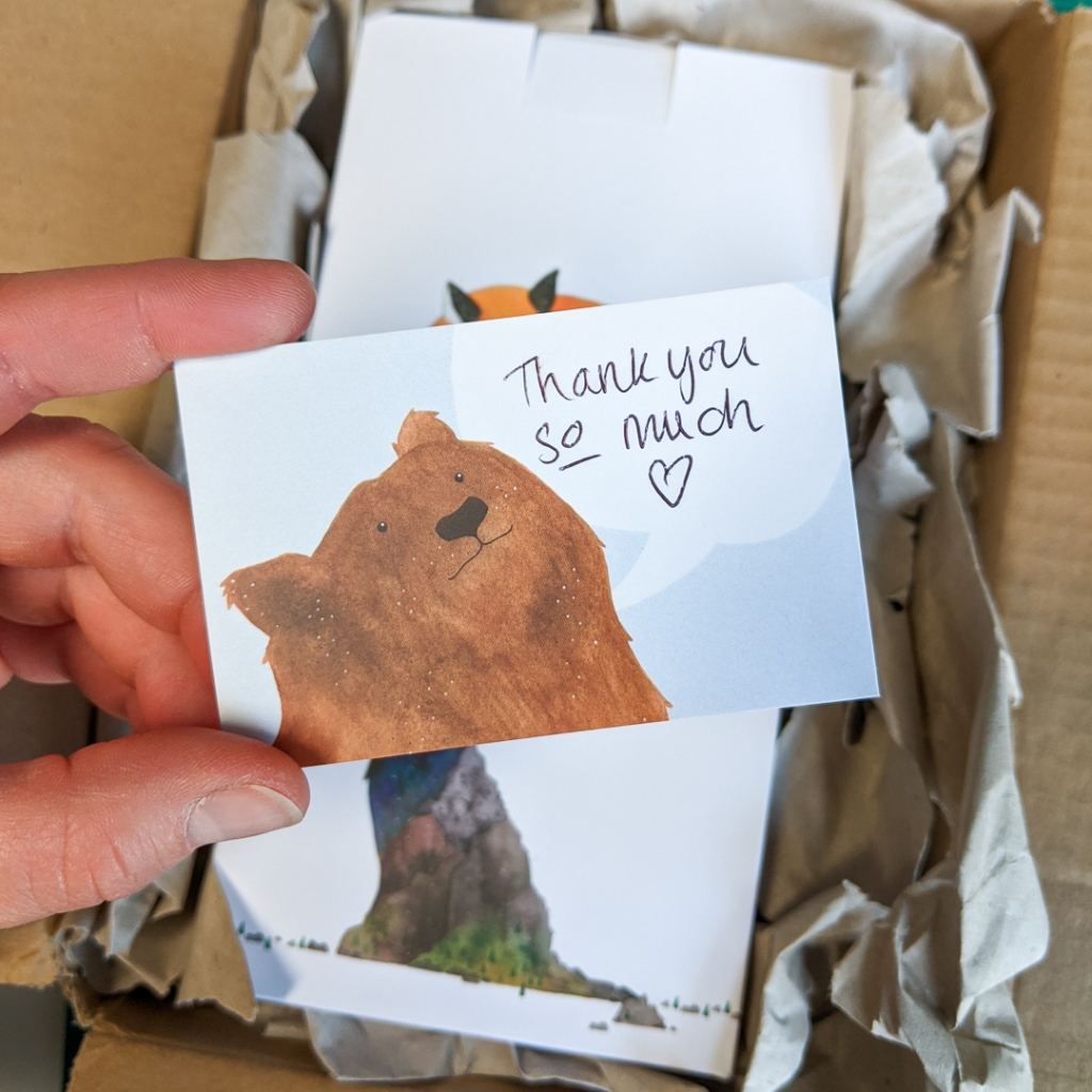 An online order with a handwritten thank you card, saying 'Thank you so much'